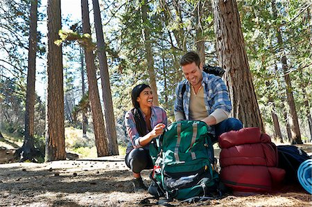 Young couple unpacking camping rucksack in forest, Los Angeles, California, USA Stock Photo - Premium Royalty-Free, Code: 614-08000191