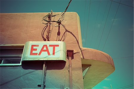 Low angle view of eat sign on cafe wall, Pescardero, California, USA Stock Photo - Premium Royalty-Free, Code: 614-08000214