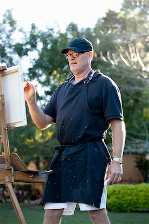 painter - Male plein-air painter in Albin Polasek Museum and Sculpture Garden, Winter Park, Florida, USA Stock Photo - Premium Royalty-Free, Code: 614-08000219
