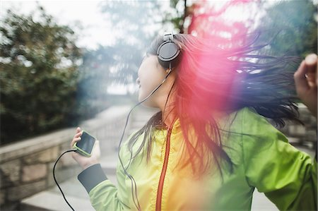 dancing - Young woman, outdoors, listening to music and dancing Stock Photo - Premium Royalty-Free, Code: 614-08000227
