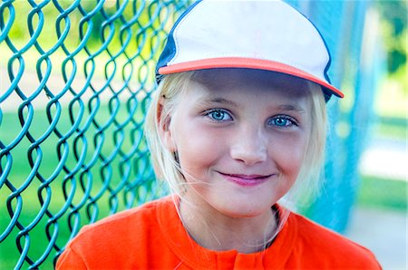 Portrait of young girl wearing baseball kit Stock Photo - Premium Royalty-Free, Code: 614-08000253