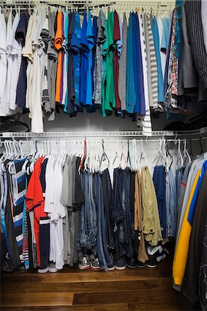 Teenage boys walk in closet in luxury home Stock Photo - Premium Royalty-Free, Code: 614-08000274