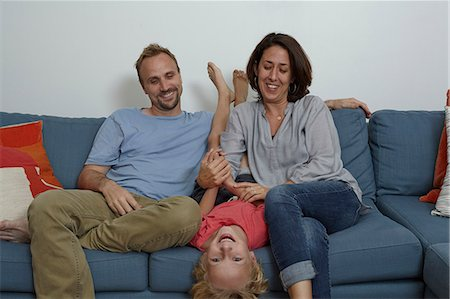 Parents with son sitting on sofa Stock Photo - Premium Royalty-Free, Code: 614-08000357