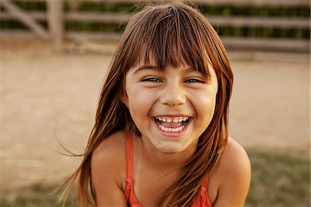 summer - Portrait of laughing girl in farmyard Stock Photo - Premium Royalty-Free, Code: 614-08000405