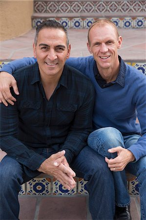Portrait of mature male couple sitting on stairs in park Stock Photo - Premium Royalty-Free, Code: 614-08030444