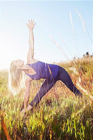 Mature woman practising yoga on field Stock Photo - Premium Royalty-Free, Code: 614-08030503
