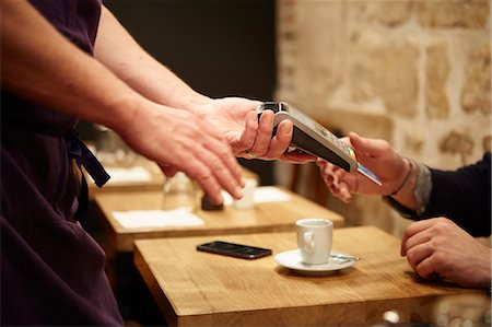 Man paying his bill in restaurant, using credit card Stock Photo - Premium Royalty-Free, Code: 614-08030800