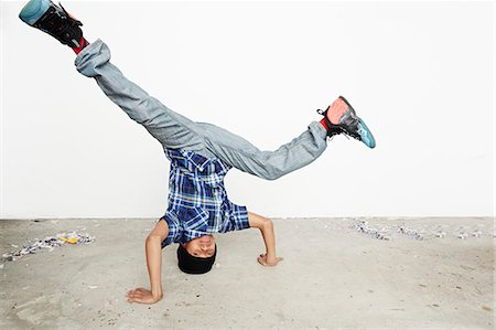 Boy breakdancing Stock Photo - Premium Royalty-Free, Code: 614-08030878
