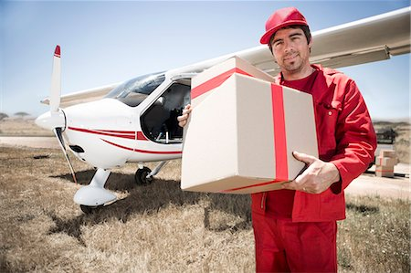 shadow - Delivery man carrying parcel off airplane, Wellington, Western Cape, South Africa Stock Photo - Premium Royalty-Free, Code: 614-08030917