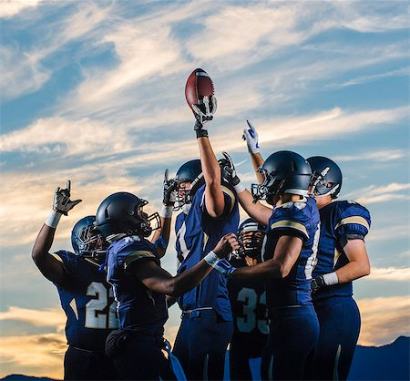 football team - Teenage and young male american football team celebrating together Stock Photo - Premium Royalty-Free, Code: 614-08031110