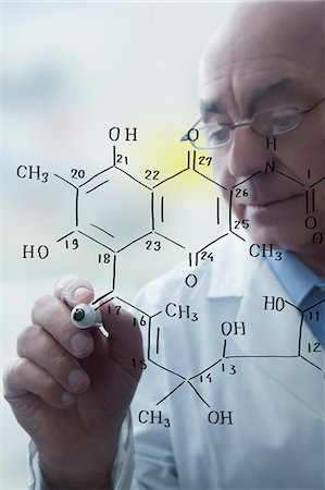 Senior male scientist writing molecular formula on clear board Stock Photo - Premium Royalty-Free, Code: 614-08065878