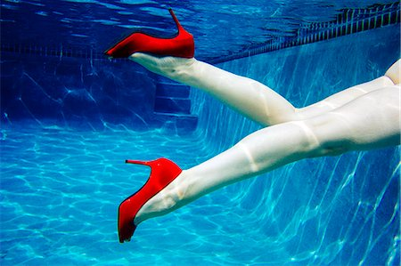 Mature woman, nude, wearing only red high heels, underwater view, low section Stock Photo - Premium Royalty-Free, Code: 614-08065892