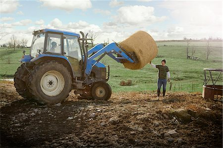farming (raising livestock) - Farming brothers driving tractor moving hay stack on dairy farm Stock Photo - Premium Royalty-Free, Code: 614-08065937