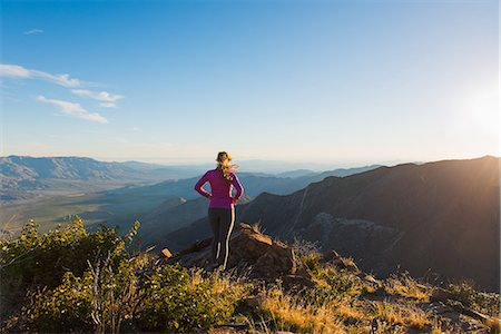 discovery - Young female trail runner looking at view on Pacific Crest Trail, Pine Valley, California, USA Stock Photo - Premium Royalty-Free, Code: 614-08066016