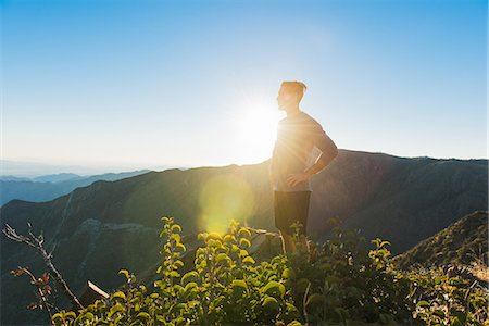 discovery - Male trail runner looking out to landscape on Pacific Crest Trail, Pine Valley, California, USA Stock Photo - Premium Royalty-Free, Code: 614-08066013