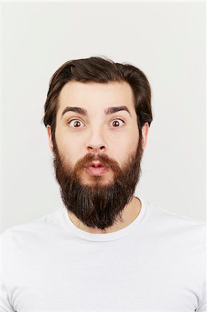 surprised - Portrait of bearded man in white t-shirt Stock Photo - Premium Royalty-Free, Code: 614-08066101