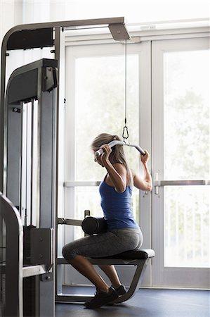 fitness older women gym - Mature woman training on gym machine Stock Photo - Premium Royalty-Free, Code: 614-08066134