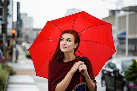 red - Young woman with red hair, holding red umbrella Stock Photo - Premium Royalty-Free, Code: 614-08081212