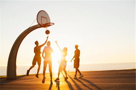 Group of friends playing basketball, outdoors Stock Photo - Premium Royalty-Free, Code: 614-08081318