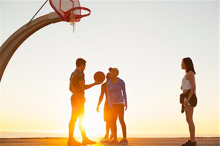 playing - Group of friends playing basketball, outdoors Stock Photo - Premium Royalty-Free, Code: 614-08081321