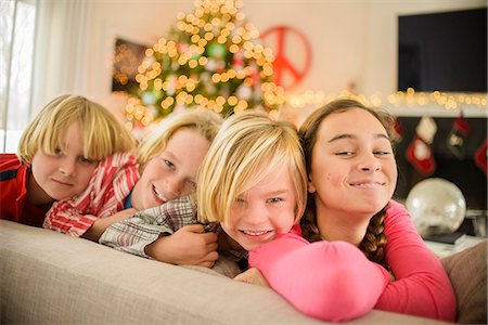 event - Portrait of teenage girl and brothers on sofa at christmas Stock Photo - Premium Royalty-Free, Code: 614-08081391