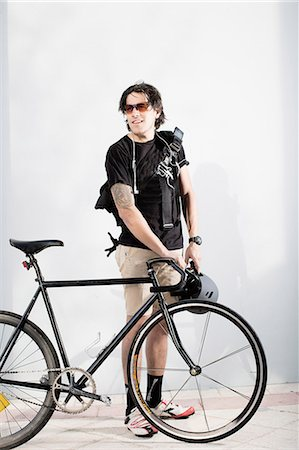 Bike messenger with bike Stock Photo - Premium Royalty-Free, Code: 614-08081419