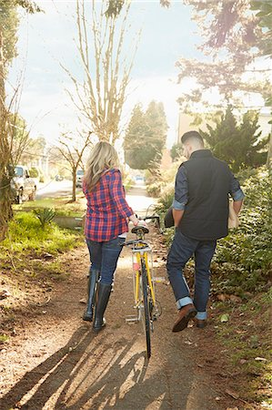 pushing - Young couple on path with bicycle Stock Photo - Premium Royalty-Free, Code: 614-08081445