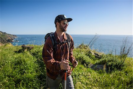 friluftsliv - Young male hiker on cliff top path, Big Sur, California, USA Stock Photo - Premium Royalty-Free, Code: 614-08119452