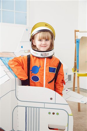 spaceship - Portrait of young girl, wearing astronaut outfit Stock Photo - Premium Royalty-Free, Code: 614-08119490