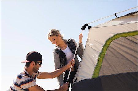 Couple setting up tent Stock Photo - Premium Royalty-Free, Code: 614-08119553