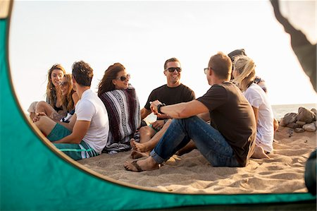 Group of friends camping on beach Stock Photo - Premium Royalty-Free, Code: 614-08119584