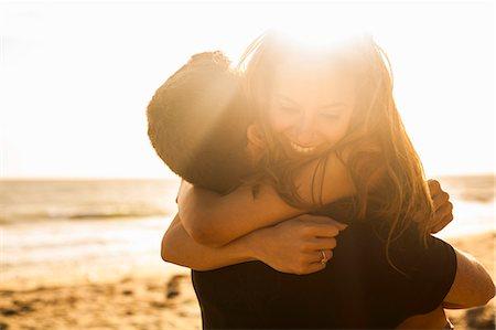 Couple having fun on beach, Malibu, California, USA Stock Photo - Premium Royalty-Free, Code: 614-08119589