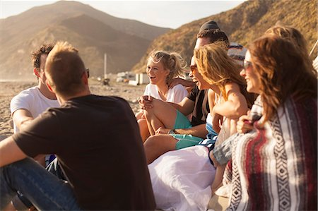 Group of friends camping on beach, Malibu, California, USA Stock Photo - Premium Royalty-Free, Code: 614-08119582