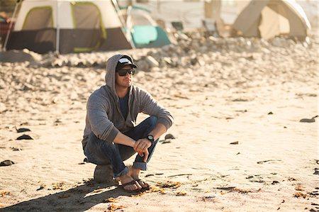 Man at beach camp, Malibu, California, USA Stock Photo - Premium Royalty-Free, Code: 614-08119618