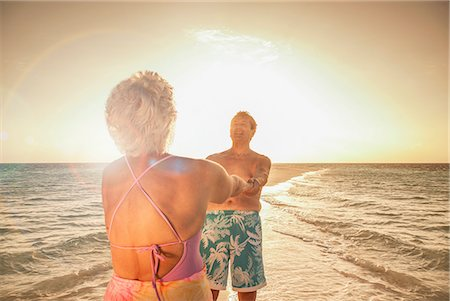 Senior couple holding hands on beach Stock Photo - Premium Royalty-Free, Code: 614-08126823
