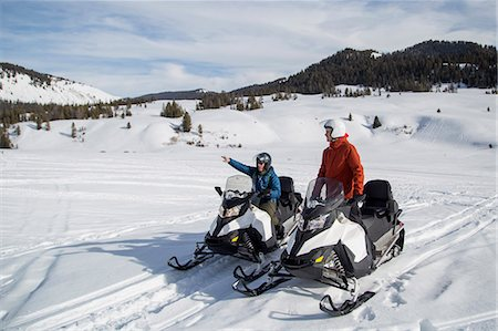 Friends on snowmobile, Jackson Hole, Wyoming Stock Photo - Premium Royalty-Free, Code: 614-08120066