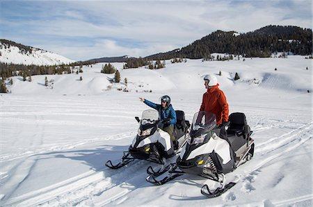 Friends on snowmobile, Jackson Hole, Wyoming Stock Photo - Premium Royalty-Free, Code: 614-08120066