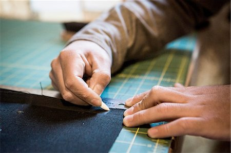 fabric - Hands of tailor marking fabric with chalk on workshop bench Stock Photo - Premium Royalty-Free, Code: 614-08148280