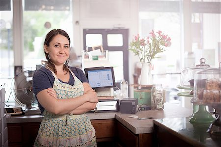 Bakery owner with arms crossed behind counter Stock Photo - Premium Royalty-Free, Code: 614-08148349