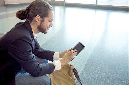 Businessman on business trip using digital tablet, New York, USA Stock Photo - Premium Royalty-Free, Code: 614-08148379