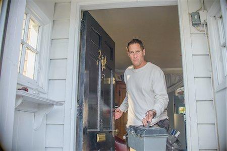 Handyman leaving house Stock Photo - Premium Royalty-Free, Code: 614-08148420