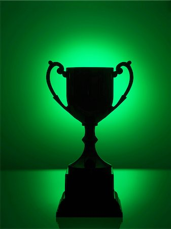 Silhouetted trophy with green background Stock Photo - Premium Royalty-Free, Code: 614-08148457