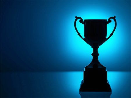 Silhouetted trophy with blue background Stock Photo - Premium Royalty-Free, Code: 614-08148458