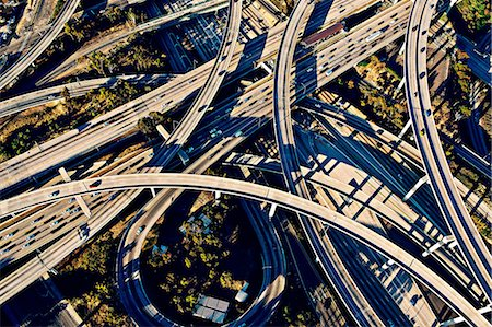 Aerial view of sunlit curved flyovers and highways, Los Angeles, California, USA Stock Photo - Premium Royalty-Free, Code: 614-08148484