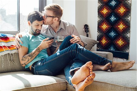 Male couple relaxing on sofa together Stock Photo - Premium Royalty-Free, Code: 614-08148655