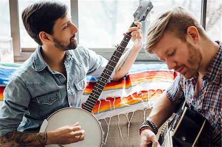 playing - Male couple at home, play guitar and banjo Stock Photo - Premium Royalty-Free, Code: 614-08148667
