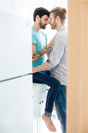 Male couple in kitchen, face to face, embracing Stock Photo - Premium Royalty-Free, Code: 614-08148662