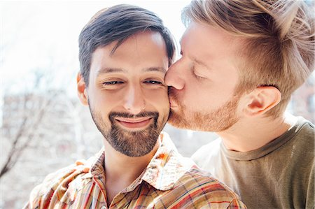 Portrait of male couple, mid adult man kissing his partner's cheek Stock Photo - Premium Royalty-Free, Code: 614-08148686