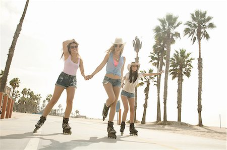 roller skate - Three young women, holding hands, inline skating Stock Photo - Premium Royalty-Free, Code: 614-08201900
