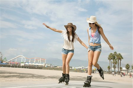 roller skate - Two young women, inline skating, Santa Monica, Los Angeles, USA Stock Photo - Premium Royalty-Free, Code: 614-08201903